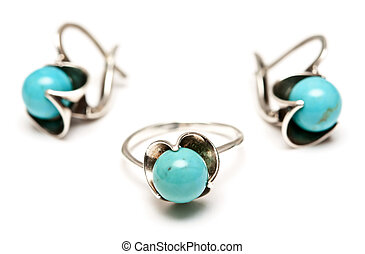 set of silver earrings and a ring