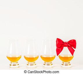 Set of single malt tasting glasses, single malt whisky in a glasses, white background