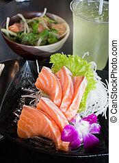 Set Of Sliced Salmon Sashimi And Green Tea, stock photo