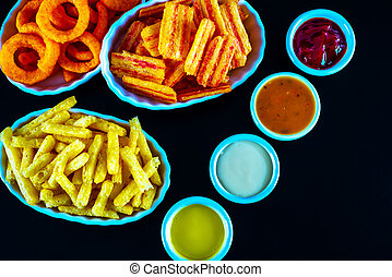 set of snacks with various dips, crispy snacks in bowls, good food
