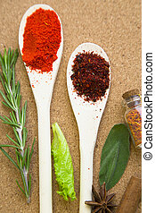 Set of spices and herbs on a corkwood