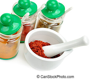 Set of spices and mortar with a pestle isolated on white background. Free space for text.