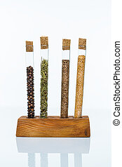 Set of spices in a glass flasks