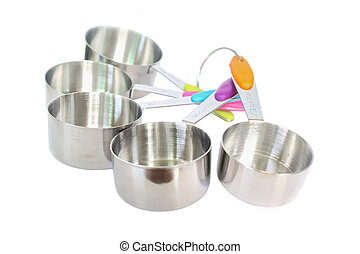 Set of stainless steel measuring spoons on white background