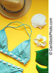 set of summer beach accessories on a yellow background