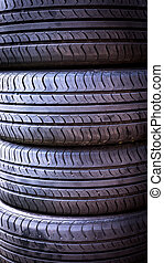 Set of summer car tires isolated. Tire stack background. Car tyre protector close up. Black rubber tire. New car tires. Close up tyre profile. Car tires in a row