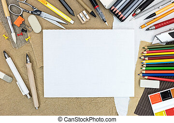 set of supplies for drawing on brown paper background
