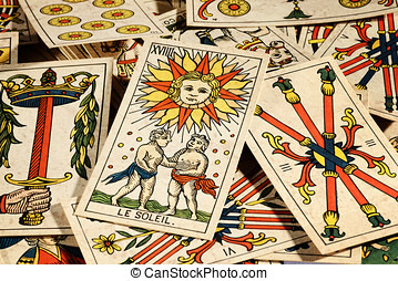 Set of tarot cards - Set of old tarot cards lying in a...