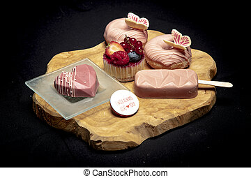 set of tasty sweets lies on a wooden board, side view