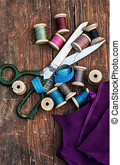 set of threads of different types,colors and lengths