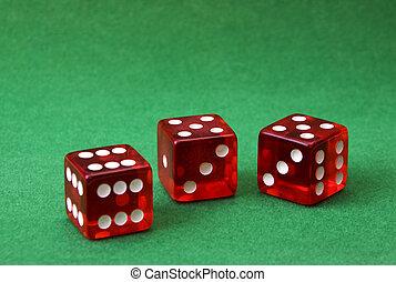 set of three dice on green