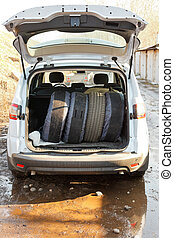set of tires in boot of car