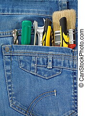 tools and instruments in jeans pocket