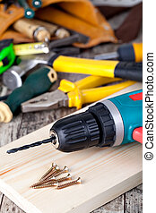 set of tools and tool box on a wooden background