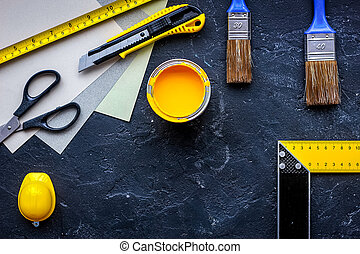 Set of tools for painting on black stone table background top view copyspace