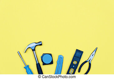Set of tools. Home improvement concept on yellow background.