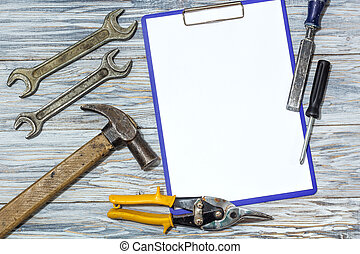 Set of tools on a wooden background, copyspace