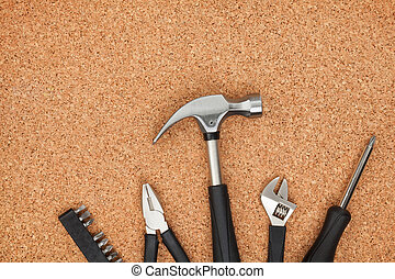 Set of tools on cork background