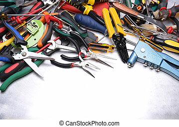 Set of tools on grey metal background