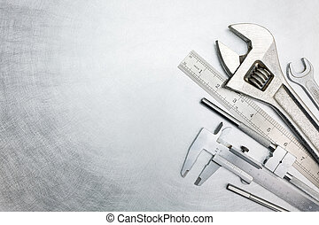 Set of tools on metal background