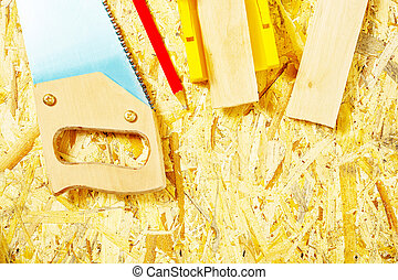 set of tools on plywood board
