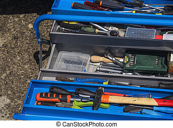 set of tools on toolbox - Toolset with interior compartments...