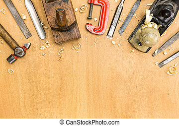 Set of tools on wood background