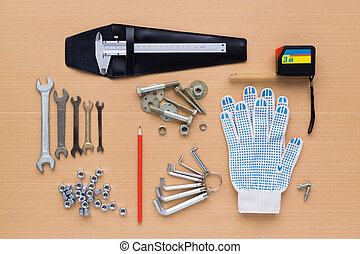 Set of tools on wooden background