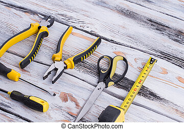 Set of tools on wooden background.