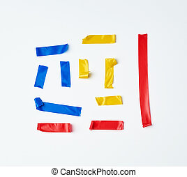 set of torn multicolored rubber pieces of electrical tape glued