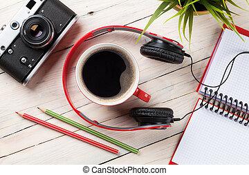 Set of travel stuff. Camera, headphones, notepad