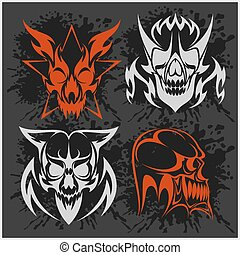 Set of tribal skulls for tattoo. Isolated on dark.