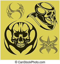 Set of tribal skulls for tattoo. Isolated on green.