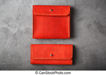 Set of two Wallets and organizer made of genuine red leather, handmade on a dark background.