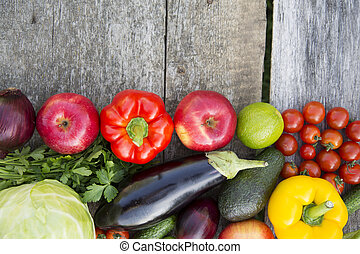 Set of various fruits and vegetables on rustic wooden background, top view. From above. Copy space.