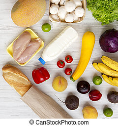 Set of various healthy food on a white wooden table, top view. Cooking food background. Healthy food concept. Close-up.