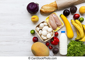 Set of various healthy food on white wooden backfround, view overhead. Cooking food background. Healthy food concept. Copy space.