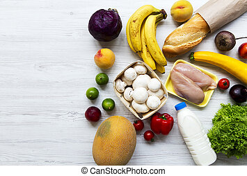 Set of various healthy food on white wooden surface, top view. Cooking food background. Health food concept. Space for text.