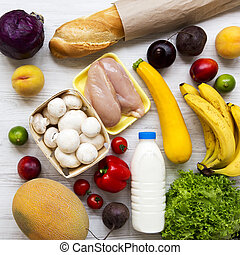 Set of various healthy food on white wooden surface, top view. Cooking food background. Healthy food concept. Closeup.