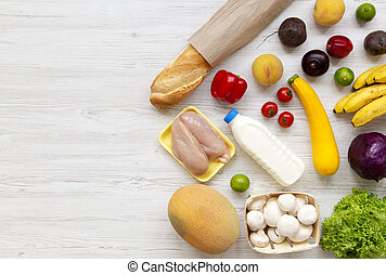 Set of various healthy food on white wooden surface, top view. Cooking food background. Healthy food concept. Space for text.
