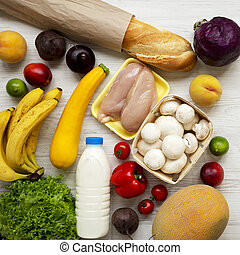 Set of various healthy food on white wooden surface, view from above. Cooking food background. Healthy food concept.