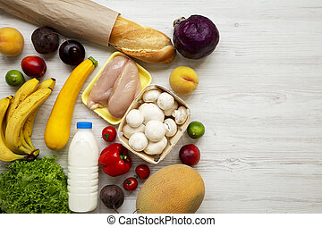 Set of various healthy food on white wooden table, top view. Cooking food background. Healthy food concept. Copy space.