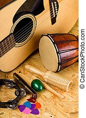 Set of various music instruments on OSB board - Vertical...