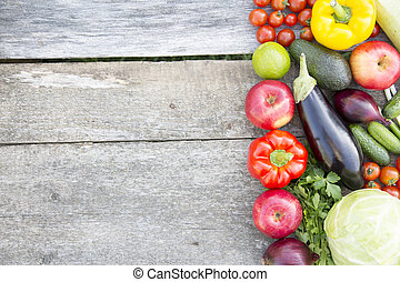 Set of various vegetables and fruits on rustic wooden background, top view. From above. Copy space.
