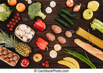 set of vegetables and fruits on wooden table