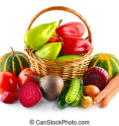 Set of vegetables in wicker basket isolated on white.