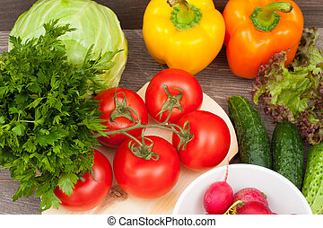 set of vegetables on a wooden background, top view
