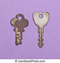 Set of Vintage Keys on a Purple Background.