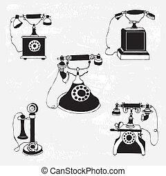 set of vintage phones on pattern background