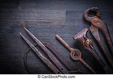 set of vintage tools on wood board